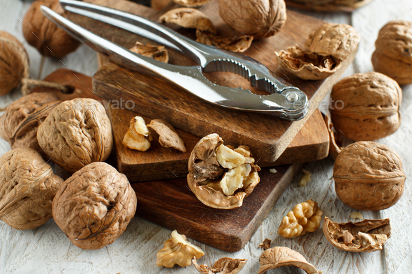 Fresh walnuts on an old wooden table - Stock Photo - Images