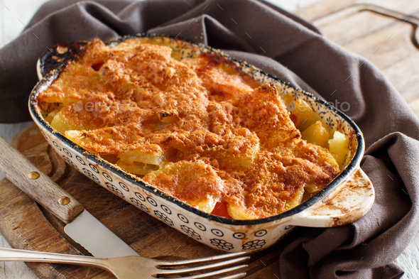 Codfish with potatoes cooked in the oven - Stock Photo - Images