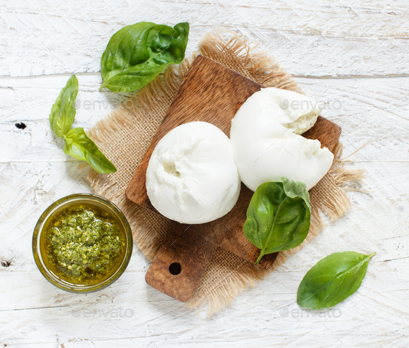 Italian mozzarella cheese stuffed with ricotta and persto - Stock Photo - Images