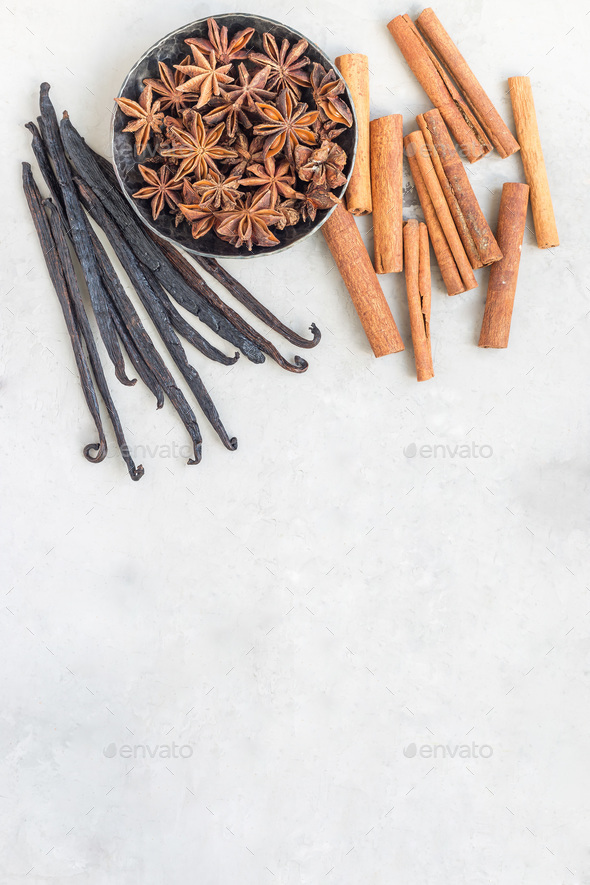 Aromatic winter spices on gray background, top view, copy space, vertical - Stock Photo - Images