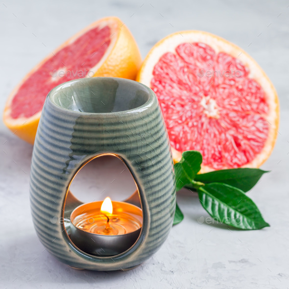 Aromatherapy lamp with grapefruit essential oil, copy space, square - Stock Photo - Images