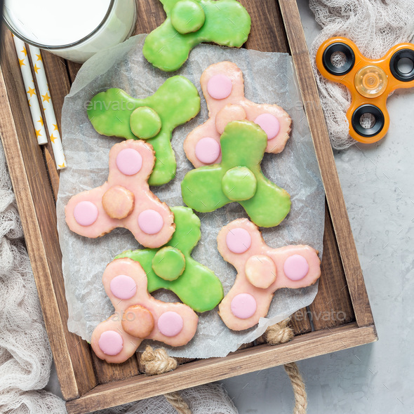 Homemade shortbread cookies made in trendy spinner toy form, top view, square format - Stock Photo - Images