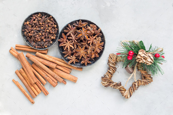 Aromatic winter spices in bowls, christmas decoration on background, top view, horizontal - Stock Photo - Images