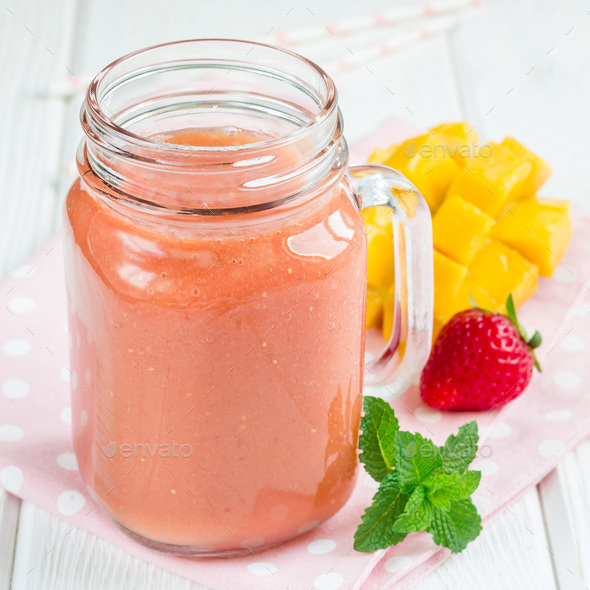 Healthy smoothie with strawberry, mango and banana in glass jars, square format - Stock Photo - Images