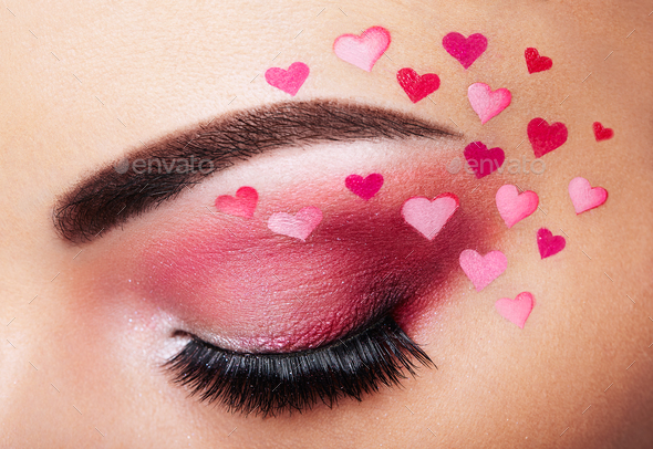 Eye make-up girl with a heart - Stock Photo - Images