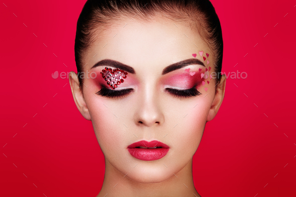 Face of beautiful woman with holiday makeup heart - Stock Photo - Images