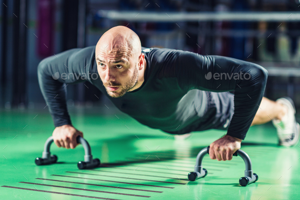 Man doing push-ups in the gym - Stock Photo - Images
