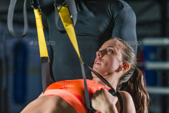 Personal trainer with woman in the gym - Stock Photo - Images