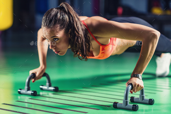 Woman doing push-ups in the gym - Stock Photo - Images