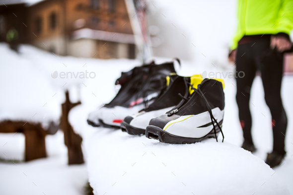 Unrecognizable couple getting ready for cross-country skiing. - Stock Photo - Images