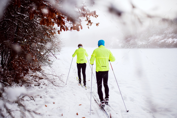Senior couple cross-country skiing. - Stock Photo - Images