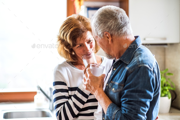 Senior couple in the kitchen. - Stock Photo - Images
