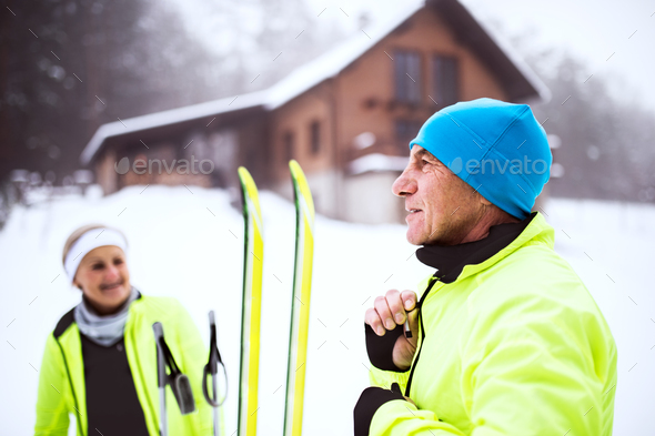 Senior couple getting ready for cross-country skiing. - Stock Photo - Images