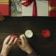Adult Man Lights Christmas Candles By Decorated Table, Top Down Shot - VideoHive Item for Sale
