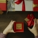Top Down Shot of Adult Man Opening Christmas Present Box with Sticky Note with Smile Inside - VideoHive Item for Sale