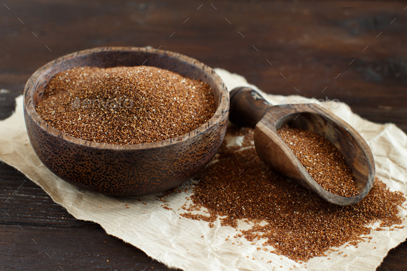 Uncooked teff grain in a bowl - Stock Photo - Images