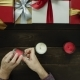 Adult Man Lights Xmas Candles By Decorated Table, Top Down Shot - VideoHive Item for Sale