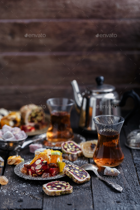 Turkish delight on a dark wood background. - Stock Photo - Images