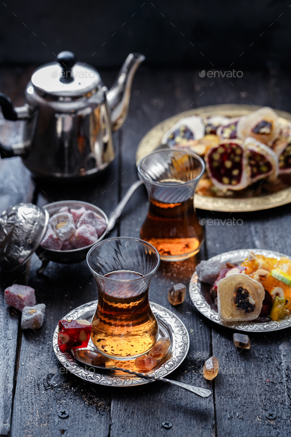 Tea in traditional turkish glasses with oriental delights and sweets - Stock Photo - Images