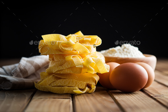 Raw tagliatelle pasta. - Stock Photo - Images