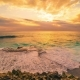 Cliff and Ocean Against the Background of an Colorful Sunset in Island Nusa Lembongan, Bali