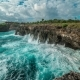 Huge Waves Break About the Rocks on the Island Nusa Ceningan, Indonesia