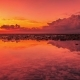Beautiful Sunset and Clouds Reflection in Sea at the Island Nusa Lembongan, Indonesia