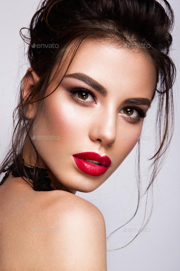 Gorgeous Young Brunette Woman face portrait. - Stock Photo - Images