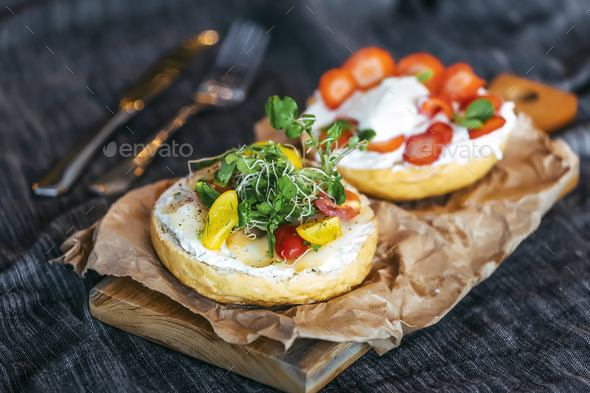 Delicious sandwich of bread,cream cheese vegetable and strawberries - Stock Photo - Images
