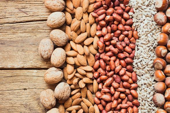 Mix of nuts Almonds, walnuts, peanuts, hazelnuts , sunflower seeds - Stock Photo - Images
