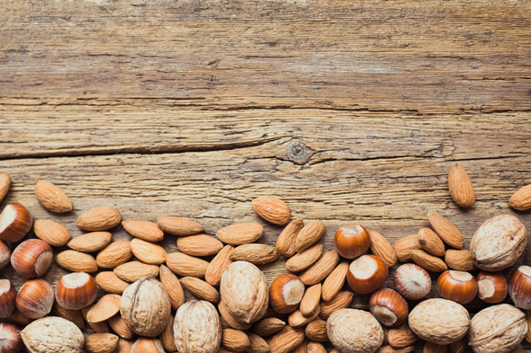 Assorted nuts in a wooden background - Stock Photo - Images