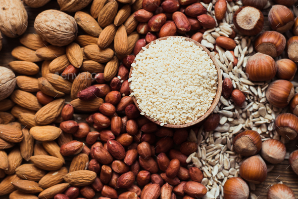 Mix of nuts Almonds, walnuts, peanuts, hazelnuts , sunflower seeds, sesame seeds - Stock Photo - Images