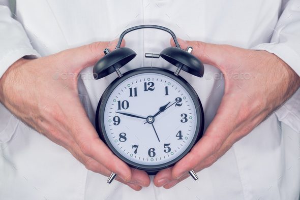 Doctor with alarm clock - Stock Photo - Images