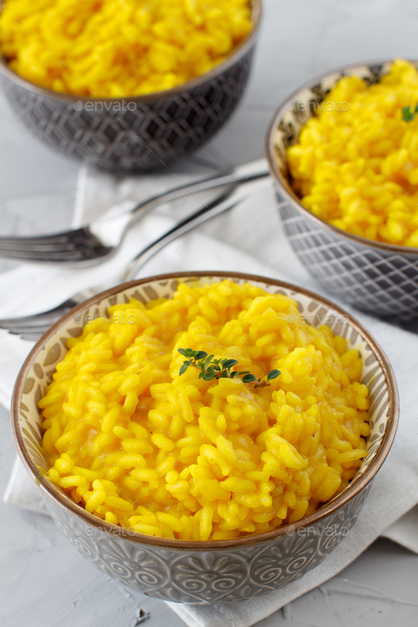 Risotto with curcuma - Stock Photo - Images