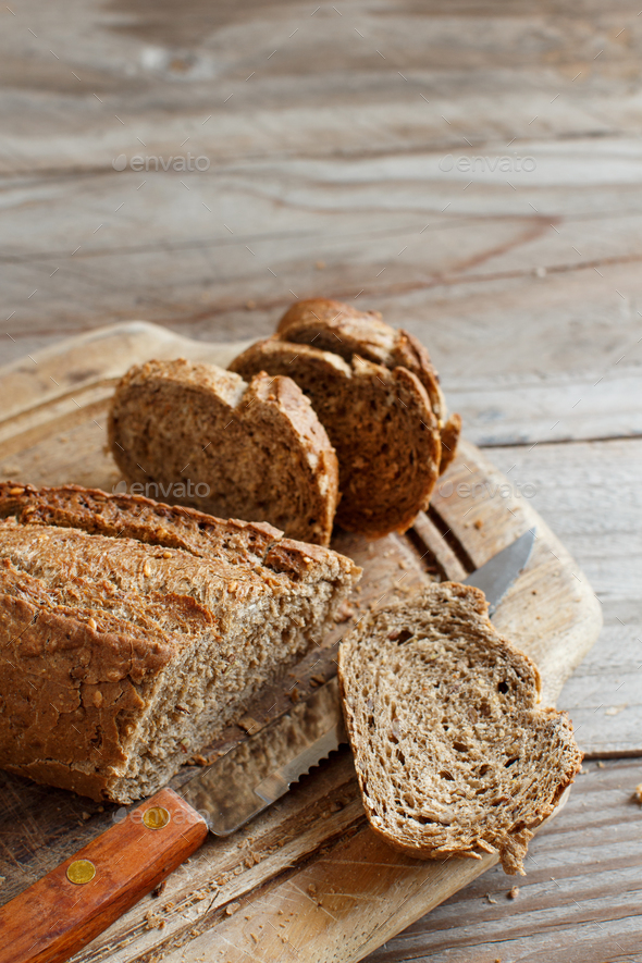 Wholemeal Bread on a Wooden Table - Stock Photo - Images