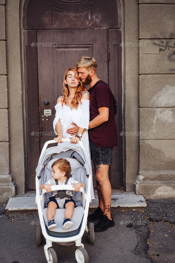 Dad and mom with a small son on the street - Stock Photo - Images