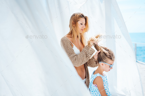 Mom and daughter spend time together - Stock Photo - Images