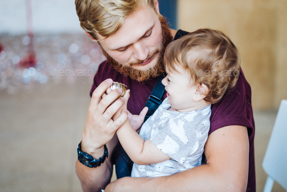 Young father holding his son - Stock Photo - Images
