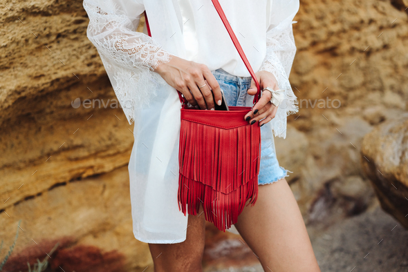 Girl with a small handbag - Stock Photo - Images