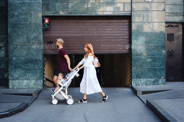 man and woman with a stroller - Stock Photo - Images