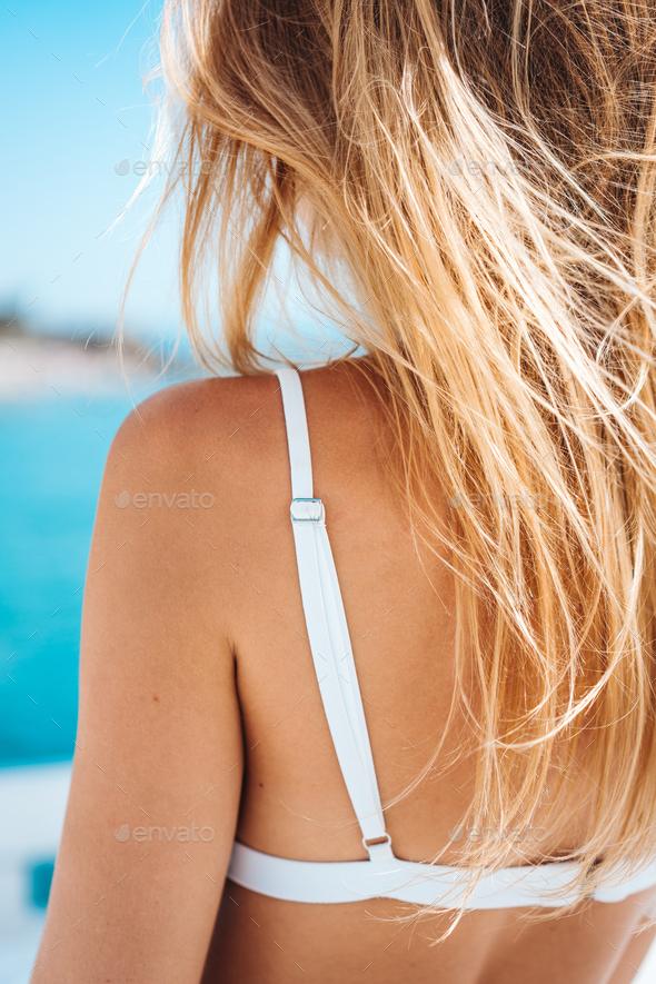 beautiful woman in white bikini - Stock Photo - Images