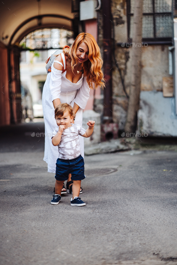 Young mother with her baby boy - Stock Photo - Images
