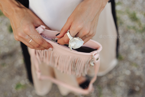 Girl closes her handbag. Close up - Stock Photo - Images