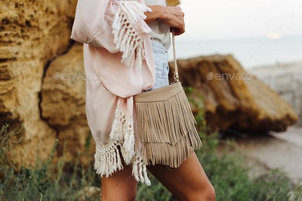 Girl with a small handbag - Stock Photo - Images