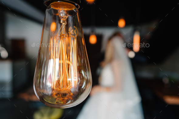 retro bulbs lights. newlyweds couple embracing - Stock Photo - Images