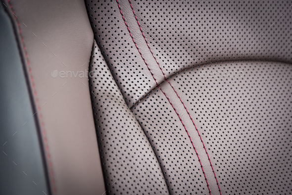 Red perforated leather details, luxury car interior - Stock Photo - Images