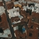Drone Flight Over the Rusty Roofs of the Old City. Chernivtsi Ukraine - VideoHive Item for Sale