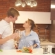 Happy Couple Drinking Wine and Eating Salad in the Kitchen at Home - VideoHive Item for Sale