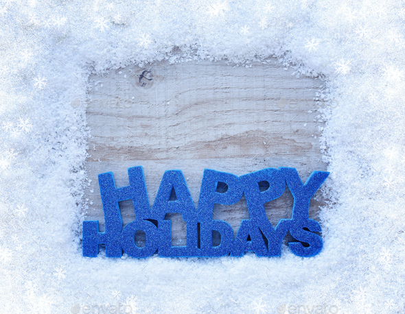 "The frame of the snow and the inscription ""Happy Holidays"" on a - Stock Photo - Images"