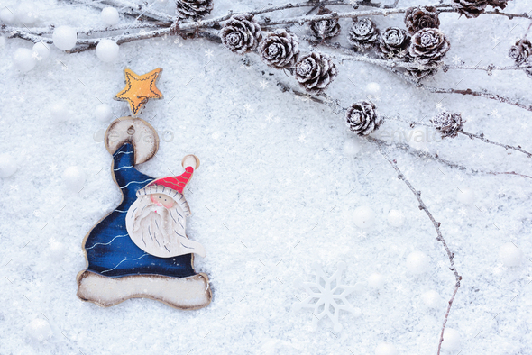 Larch branches with cones and Santa Claus on the snow. Christmas - Stock Photo - Images
